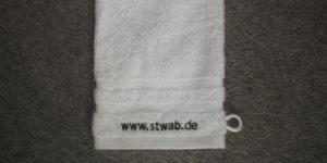 Logo auf Waschhandschuh
